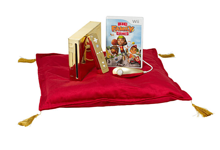 Gold Wii console and Big Family Games on red cusion