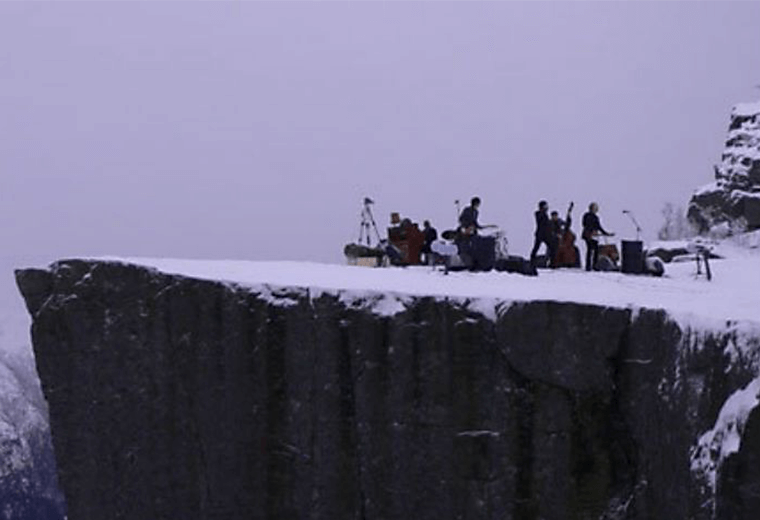 Adjagas perform on a mountain platform 600 metres above Lyse Fjord.