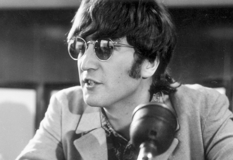 John Lennon wearing his trademark sunglasses