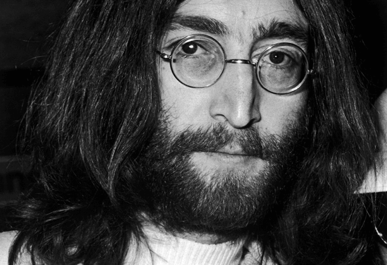 John Lennon with long hair and beard