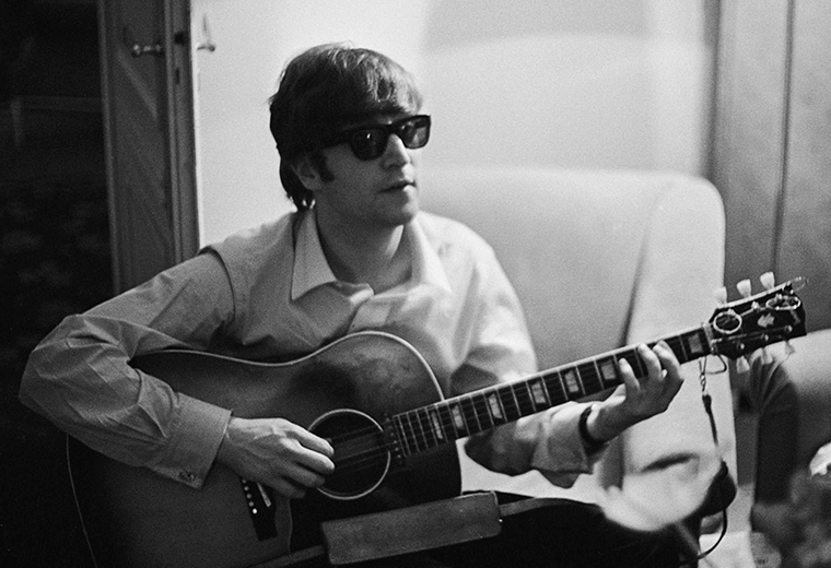 John Lennon playing guitar