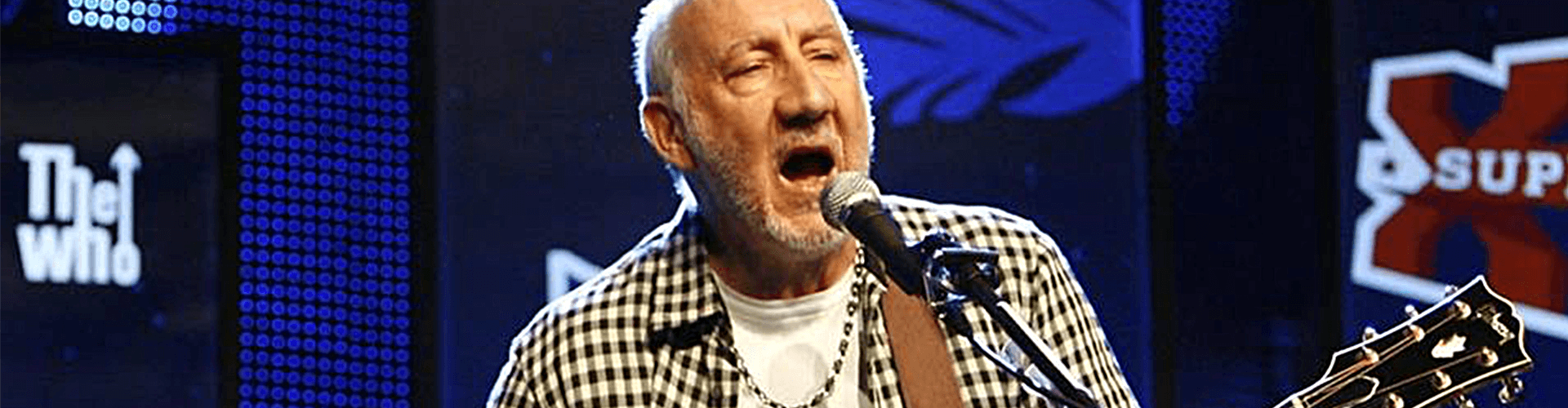 Pete Townsend performing a celebration of The Who.