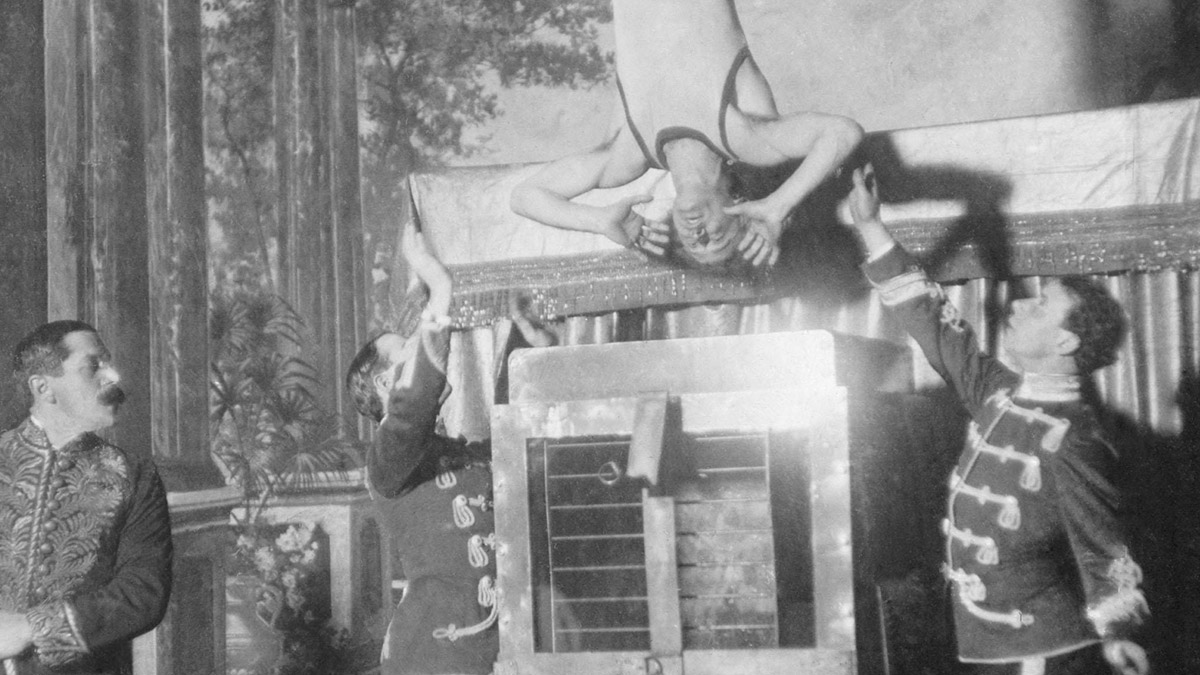 Harry Houdini being lowered into the Chinese water torture cell