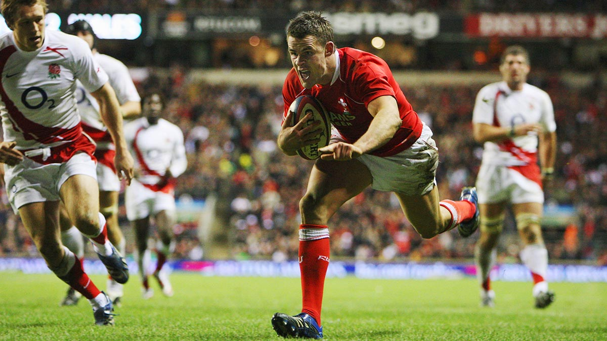Wales' Mike Phillips scoring a try against England