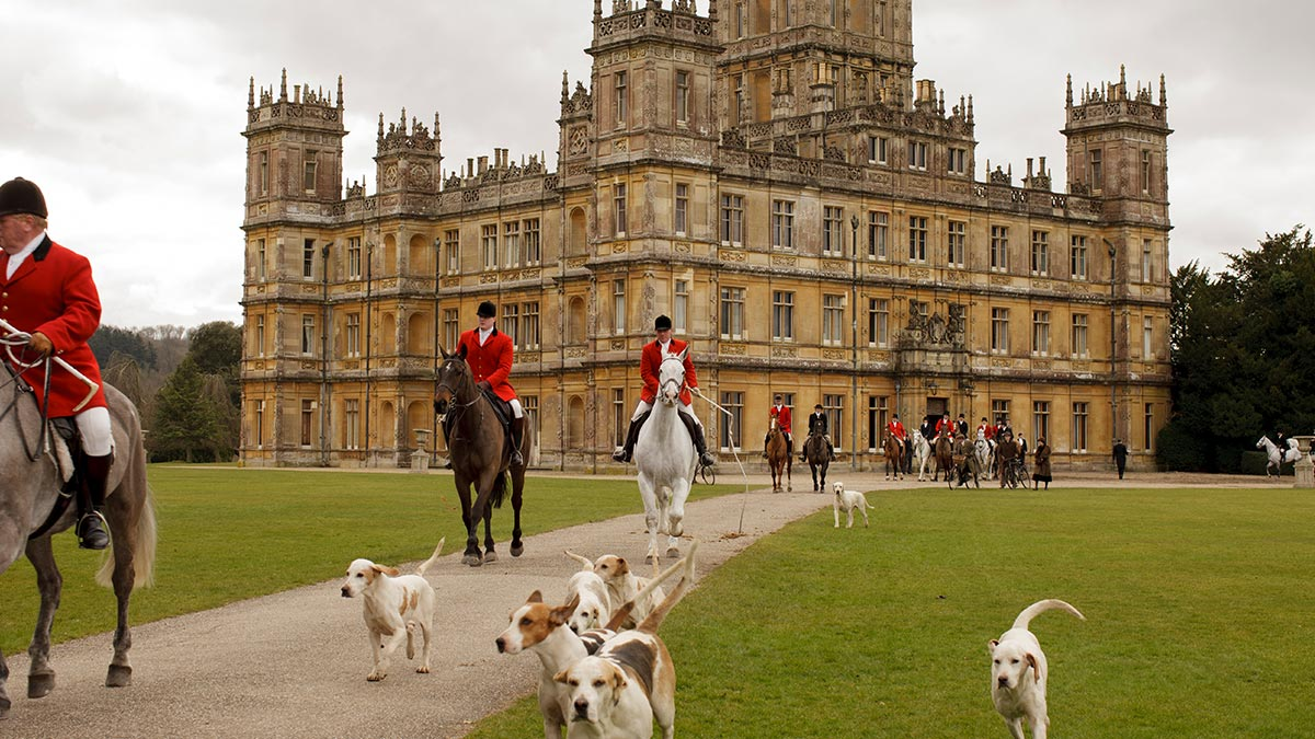 Highclere Castle with a hunting party in the foreground