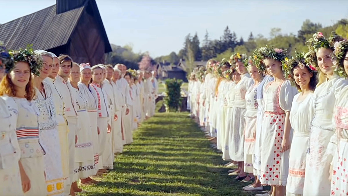 Cult members form a walkway in Midsommar