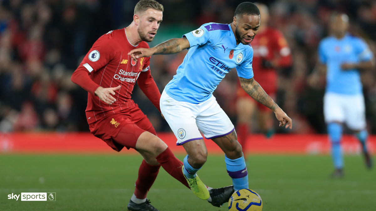 Jordan Henderson of Liverpool takes on Raheem Sterling of Manchester City