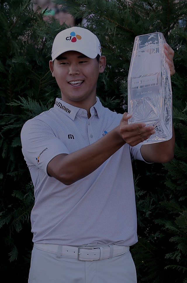 Kim Si-woo with Players Championship Trophy